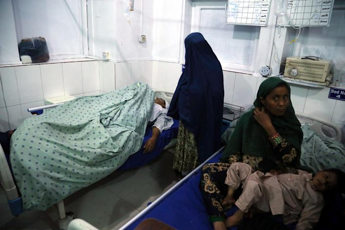 <p>An Afghan woman who was injured when unknown gunmen opened fire and killed Afghan female journalists of Enikas Radio Television Network, receives medical treatment at a hospital, in Jalalabad, Afghanistan</p> (EPA)