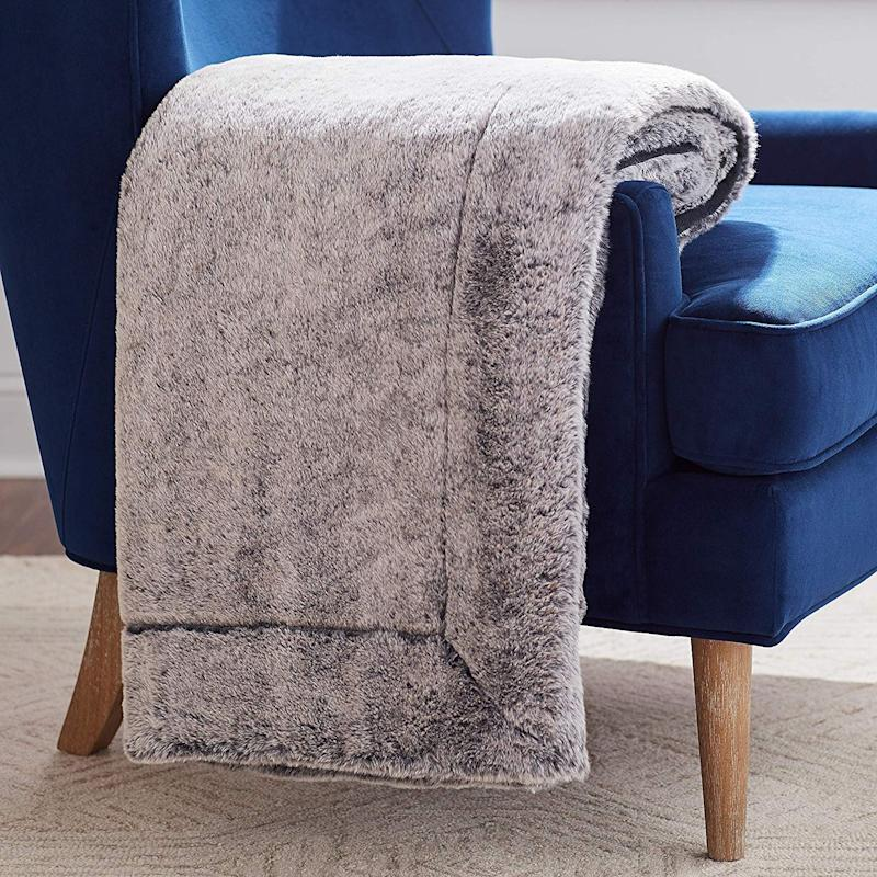 This faux fur throw is so soft, you'll want to spend all weekend curled up in it. (Photo: Amazon)