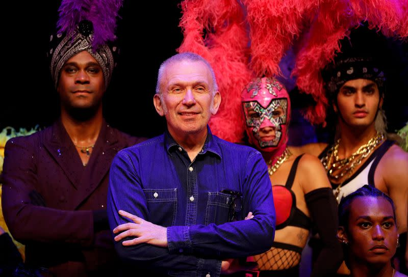 "Designer Jean Paul Gaultier poses for a photograph with members of the cast of ""Fashion Freak Show"" prior to its opening at the Southbank Centre in London"