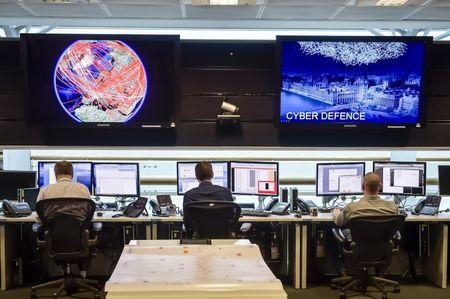 FILE PHOTO - People sit at computers in the 24 hour Operations Room inside GCHQ, Cheltenham in Cheltenham