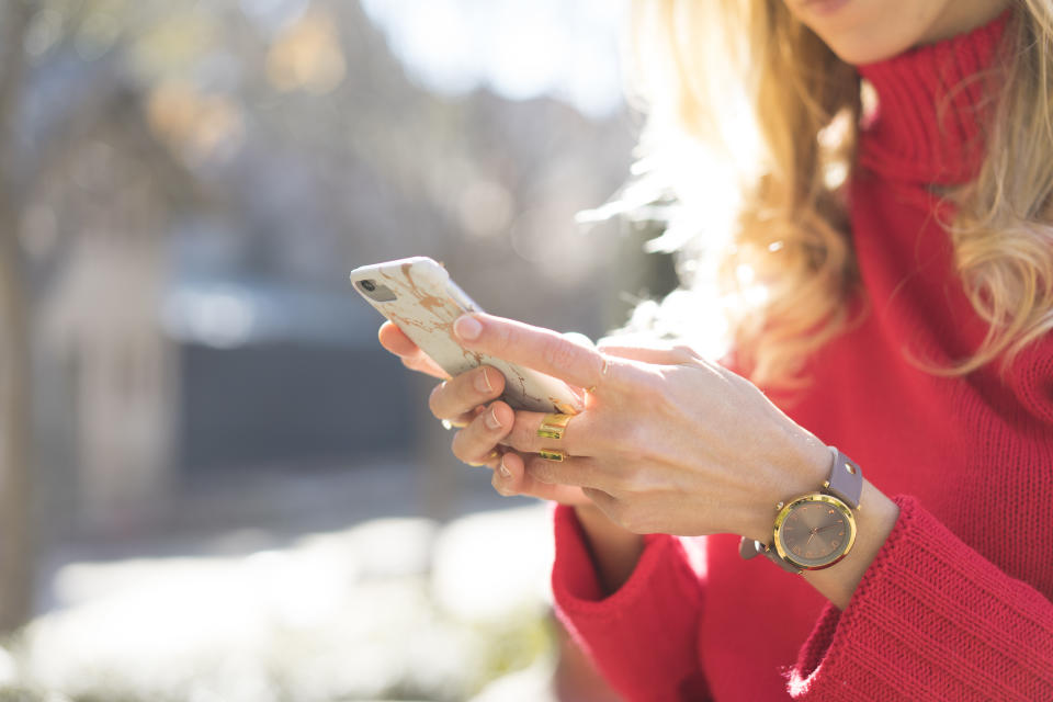 Close-up of woman using smartphone in a garden