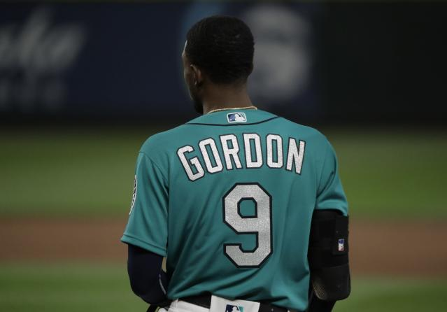 Seattle Mariners' Dee Gordon stands on the field during a baseball game against the Chicago White Sox, Friday, July 20, 2018, in Seattle. (AP Photo/Ted S. Warren)