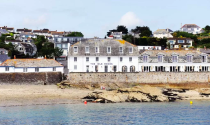 "<p>On the quayside in the traditional fishing village of St Mawes in Cornwall, <a href=""https://go.redirectingat.com?id=127X1599956&url=https%3A%2F%2Fwww.booking.com%2Fhotel%2Fgb%2Fthe-idle-rocks-hotel.en-gb.html%3Faid%3D1922306%26label%3Dstaycation-uk&sref=https%3A%2F%2Fwww.goodhousekeeping.com%2Fuk%2Flifestyle%2Ftravel%2Fg34842793%2Fstaycation-uk%2F"" rel=""nofollow noopener"" target=""_blank"" data-ylk=""slk:The Idle Rocks"" class=""link rapid-noclick-resp"">The Idle Rocks</a> boasts excellent sea views and fresh seafood. <br></p><p>On this UK staycation, the food is sourced locally and the head chef is also a keen forager. Breakfast includes unique twists, such as Birch Tree syrup, and there is also a range of brunch dishes on offer. </p><p>You can enjoy a cocktail in the bar, or on the terrace which offers lovely sea views.</p><p>The village is home to St Mawes Castle, coastal and inland walks and watersports. Falmouth is a mile away by ferry, which operates year-round and Trelissick Gardens, St Austell and Truro town centres are 30-minutes drive away. </p><p>Want to amp up the glamour? You can arrive to The Idle Rocks by boat, on the Falmouth Foot Ferry.</p><p><a href=""https://www.goodhousekeepingholidays.com/offers/cornwall-st-mawes-the-idle-rocks-hotel"" rel=""nofollow noopener"" target=""_blank"" data-ylk=""slk:Read our hotel review of The Idle Rocks here"" class=""link rapid-noclick-resp"">Read our hotel review of The Idle Rocks here</a></p><p><a class=""link rapid-noclick-resp"" href=""https://go.redirectingat.com?id=127X1599956&url=https%3A%2F%2Fwww.booking.com%2Fhotel%2Fgb%2Fthe-idle-rocks-hotel.en-gb.html%3Faid%3D1922306%26label%3Dstaycation-uk&sref=https%3A%2F%2Fwww.goodhousekeeping.com%2Fuk%2Flifestyle%2Ftravel%2Fg34842793%2Fstaycation-uk%2F"" rel=""nofollow noopener"" target=""_blank"" data-ylk=""slk:CHECK AVAILABILITY"">CHECK AVAILABILITY</a></p>"