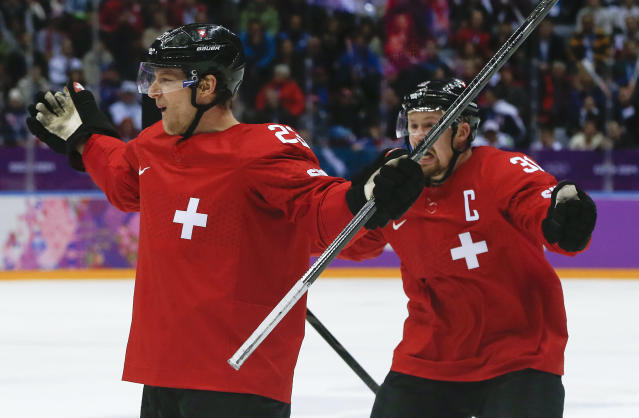 Switzerland forward Simon Bodenmann celebrates with Switzerland defenseman Mathias Seger after scoring a goal against the Czech Republic in the first period of a men's ice hockey game at the 2014 Winter Olympics, Saturday, Feb. 15, 2014, in Sochi, Russia. (AP Photo/Julio Cortez)