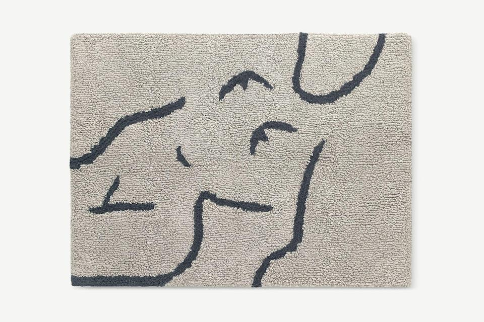 """<strong>Under £50</strong><br><br>Bath mats aren't glamorous – but they are necessary. Everything else I've seen has been quite plain and boring but I like the artsy, abstract body pattern on this one.<br><br><strong>Made</strong> 100% Cotton Bath Mat, Large 70 x 100cm, Mist Grey, $, available at <a href=""""https://www.made.com/carla-100-cotton-bath-mat-large-70-x-100cm-mist-grey"""" rel=""""nofollow noopener"""" target=""""_blank"""" data-ylk=""""slk:Made"""" class=""""link rapid-noclick-resp"""">Made</a>"""