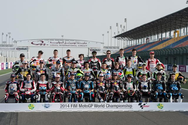 DOHA, QATAR - MARCH 20: The Moto3 riders poses for the official photo in start line on track during the MotoGp of Qatar - Free Practice at Losail Circuit on March 20, 2014 in Doha, Qatar. (Photo by Mirco Lazzari gp/Getty Images)