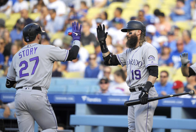 Colorado Rockies' Trevor Story, left, is congratulated by Charlie Blackmon after hitting a solo home run during the first inning of a baseball game against the Los Angeles Dodgers Monday, Sept. 2, 2019, in Los Angeles. (AP Photo/Mark J. Terrill)