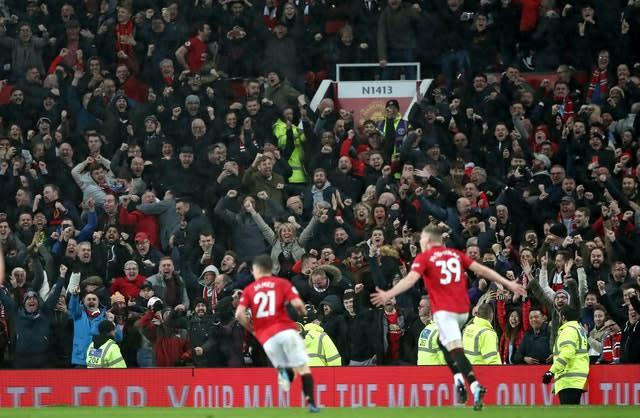 Scott McTominay celebrates scoring Manchester United's second against Manchester City in March (Nick Potts/PA)