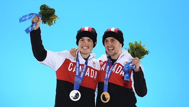 SOCHI, RUSSIA - FEBRUARY 11: Silver medalist Mikael Kingsbury of Canada (L) and gold medalist Alex Bilodeau of Canada celebrate on the podium during the medal ceremony for the for the Freestyle Skiing Men's Moguls on day 4 of the Sochi 2014 Winter Olympics at Medals Plaza on February 11, 2014 in Sochi, . (Photo by Streeter Lecka/Getty Images)