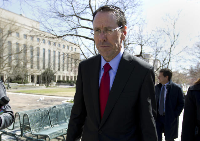 In this March 22, 2018 file photo, AT&T CEO Randall Stephenson leaves the federal courthouse in Washington. (AP Photo/Jose Luis Magana