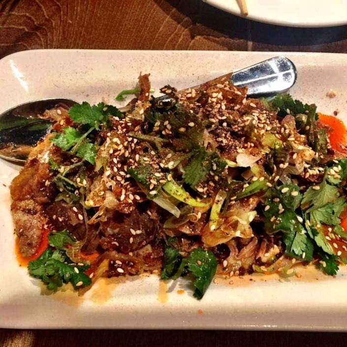At Lam's Kitchen, beef tendon and tripe is tender and served cold in a fiery mixture of hot chile oil, sesame seeds and cilantro.