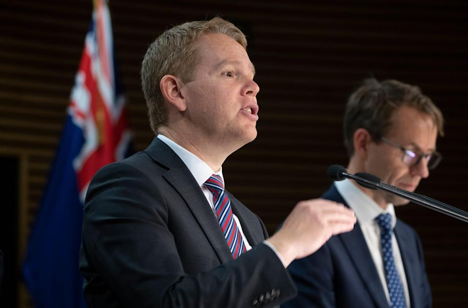 Covid-19 Response Minister Chris Hipkins and director general of health Dr Ashley Bloomfield address a press conference in Wellington (AP)