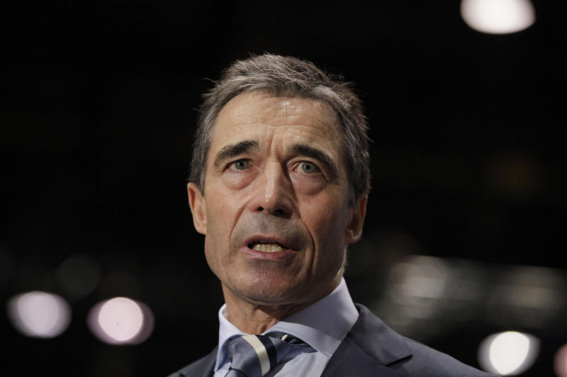 NATO Secretary General Anders Fogh Rasmussen speaks to media before state and government leaders arrive at the NATO Summit in Chicago Sunday, May 20, 2012. (AP Photo/Carolyn Kaster)