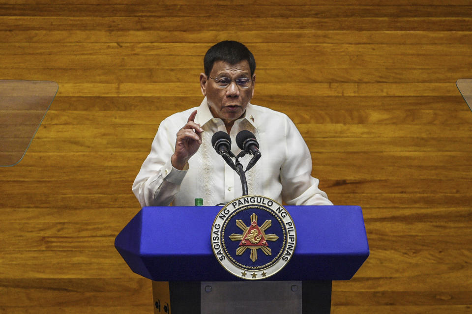 Philippine President Rodrigo Duterte delivers his final State of the Nation Address at the House of Representatives in Quezon City, Philippines on Monday, July 26, 2021. Duterte delivered his final State of the Nation speech Monday before Congress, winding down his six-year term amid a raging pandemic, a battered economy and a legacy overshadowed by a bloody anti-drug crackdown that set off complaints of mass murder before the International Criminal Court. (Jam Sta Rosa/Pool Photo via AP)