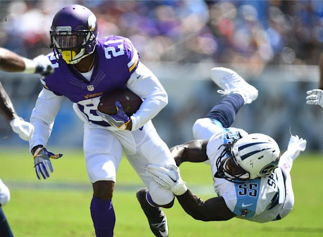 <p>Minnesota Vikings running back Jerick McKinnon (21) runs for a short gain after a missed tackle by Tennessee Titans linebacker Sean Spence (55) during the firs thalf at Nissan Stadium. Mandatory Credit: Christopher Hanewinckel-USA TODAY Sports </p>