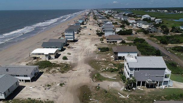 PHOTO: Oak Island sustained wind and flood damage caused by Hurricane Isaias leaving the streets strewn with debris and covered with more than a foot of sand in areas close to the beach, Aug. 4, 2020, in North Carolina.  (Travis Long/The News & Observer via AP)
