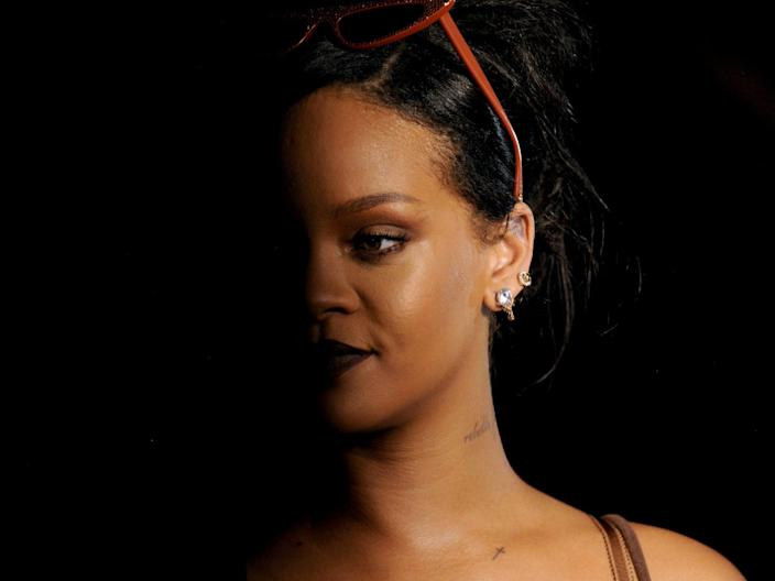 Rihanna's face partly in shadow at Savage X Fenty fashion show