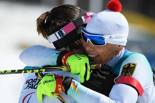 Andrea Eskau GER (R) celebrates with Marta Zainullina NPA as she crosses the finish line during the Biathlon Sitting Women's 10km at the Alpensia Biathlon Centre. The Paralympic Winter Games, PyeongChang, South Korea, Tuesday 13th March 2018. OIS/IOC/Thomas Lovelock/Handout via Reuters