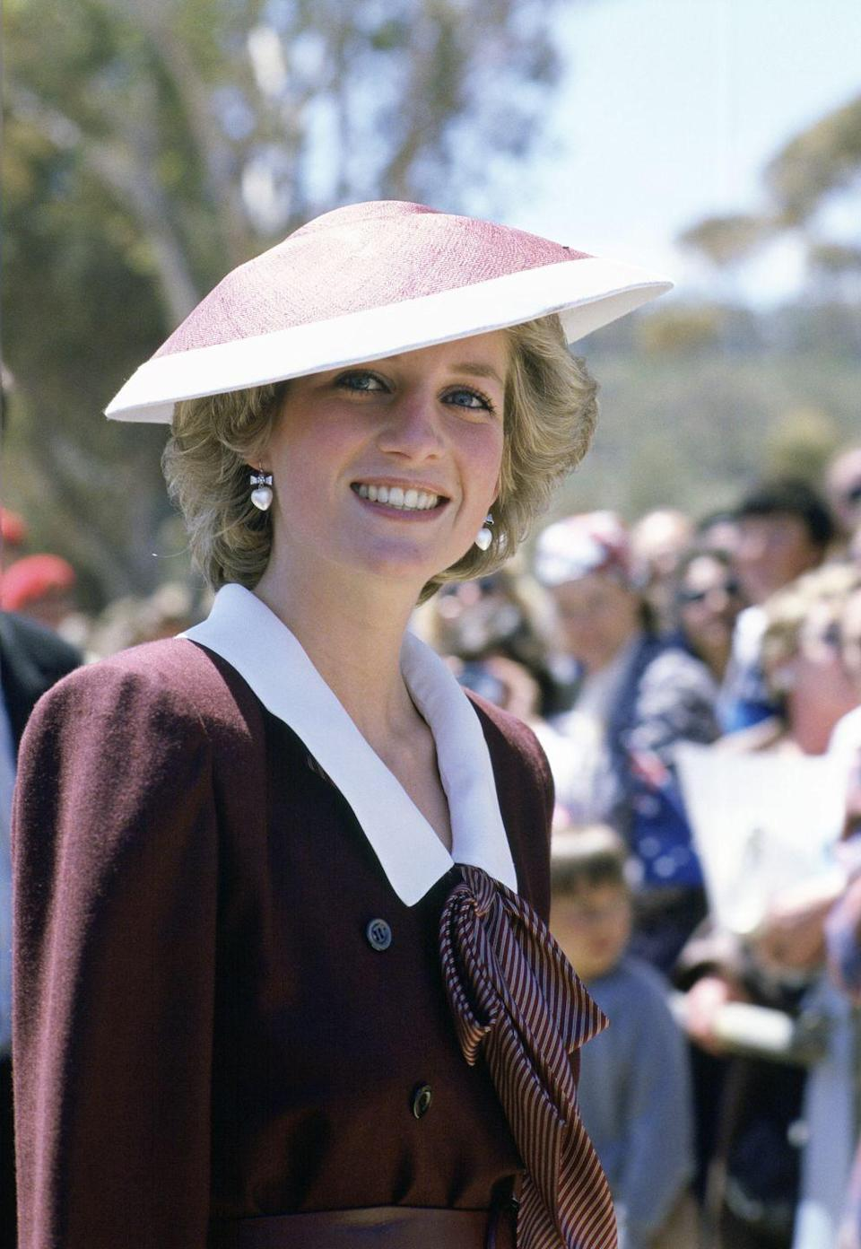 <p>Diana wearing a sailor collar with a bow tie on an official visit to Italy.</p>