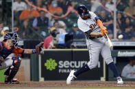 Detroit Tigers' Renato Nunez hits a two-run home run in front of Houston Astros catcher Jason Castro during the fourth inning of a baseball game Tuesday, April 13, 2021, in Houston. (AP Photo/Michael Wyke)