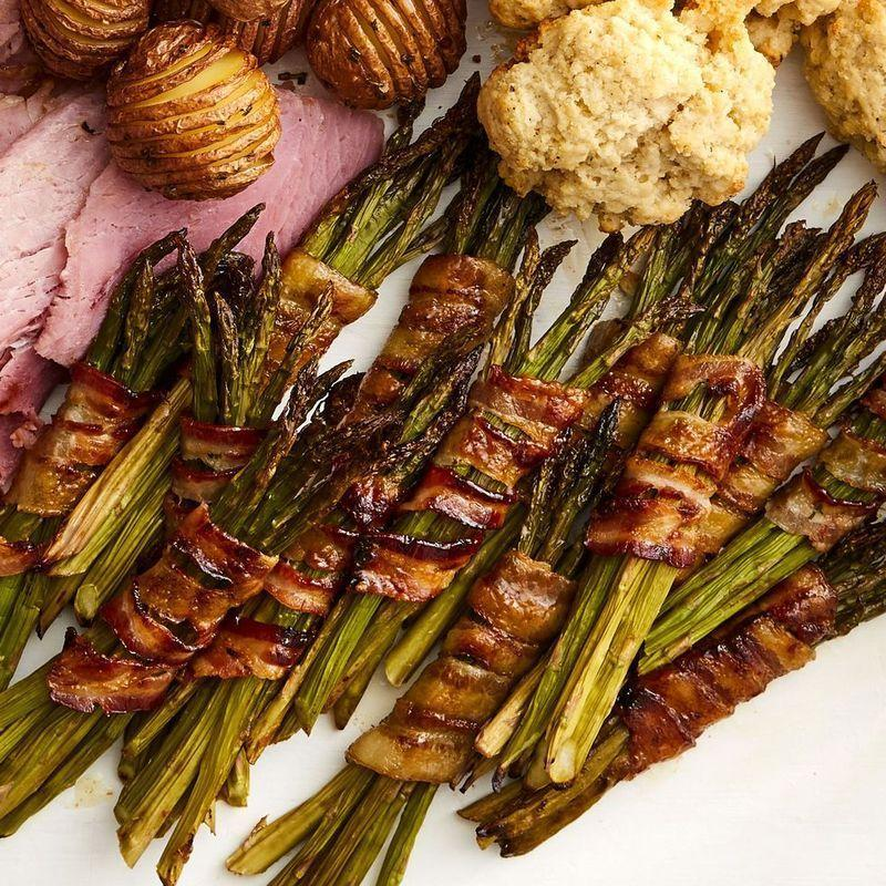 """<p>Elegant little bundles of asparagus aren't just nice to look at; they're also perfectly seasonal. (The bacon, meanwhile, is just for fun.)</p><p><strong><a href=""""https://www.thepioneerwoman.com/food-cooking/recipes/a35565767/bacon-wrapped-asparagus-bundles-recipe/"""" rel=""""nofollow noopener"""" target=""""_blank"""" data-ylk=""""slk:Get the recipe"""" class=""""link rapid-noclick-resp"""">Get the recipe</a>.</strong></p><p><a class=""""link rapid-noclick-resp"""" href=""""https://go.redirectingat.com?id=74968X1596630&url=https%3A%2F%2Fwww.walmart.com%2Fsearch%2F%3Fquery%3Dbasting%2Bbrush&sref=https%3A%2F%2Fwww.thepioneerwoman.com%2Ffood-cooking%2Fmeals-menus%2Fg36004463%2Fmemorial-day-appetizers%2F"""" rel=""""nofollow noopener"""" target=""""_blank"""" data-ylk=""""slk:SHOP BASTING BRUSHES"""">SHOP BASTING BRUSHES</a></p>"""