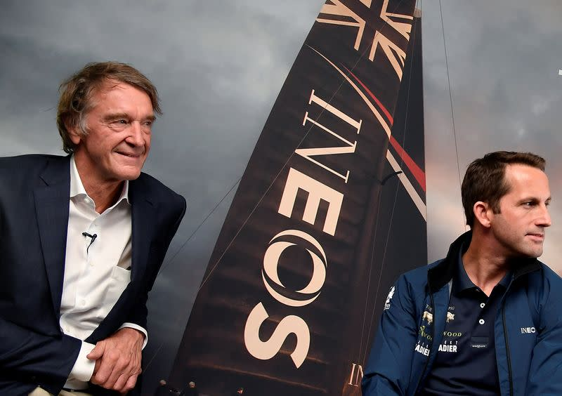 FILE PHOTO: Ratcliffe, CEO of British petrochemicals company INEOS poses for a photograph with British Olympic sailor Ainslie, during a news conference to announce the launch of a British America's Cup sailing team in London, Britain