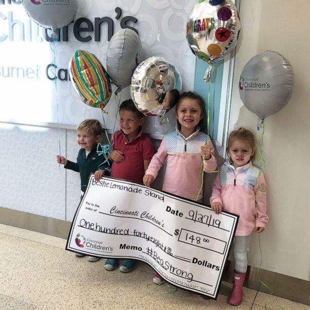 PHOTO: The kids delivered the money they raised for the Cincinnati children's hospital in the form of a big check. (Courtesy Hillary Weidner)