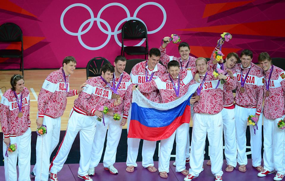 Russian players pose on the podium with their bronze medals of the London 2012 Olympic Games men's basketball competition at the North Greenwich Arena in London on August 12, 2012. The US won the gold medal followed by the silver to Spain and the bronze to Russia. AFP PHOTO /EMMANUEL DUNAND        (Photo credit should read EMMANUEL DUNAND/AFP/GettyImages)