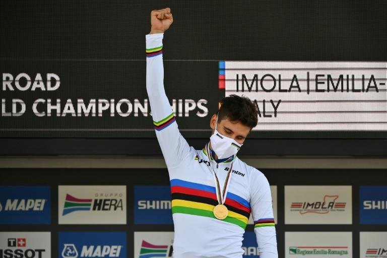 Filippo Ganna celebrates on the podium in his time trial world champion rainbow jersey
