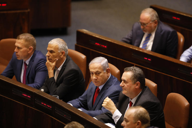 Israeli Prime Minister Benjamin Netanyahu before voting in the Knesset, Israel's parliament in Jerusalem, Wednesday, May 29, 2019. Israeli Prime Minister Benjamin Netanyahu faced a deadline at midnight Wednesday to form a new governing coalition as he tried to stave off a crisis that could trigger an unprecedented second election this year or even force the longtime leader to step down. (AP Photo/Sebastian Scheiner)