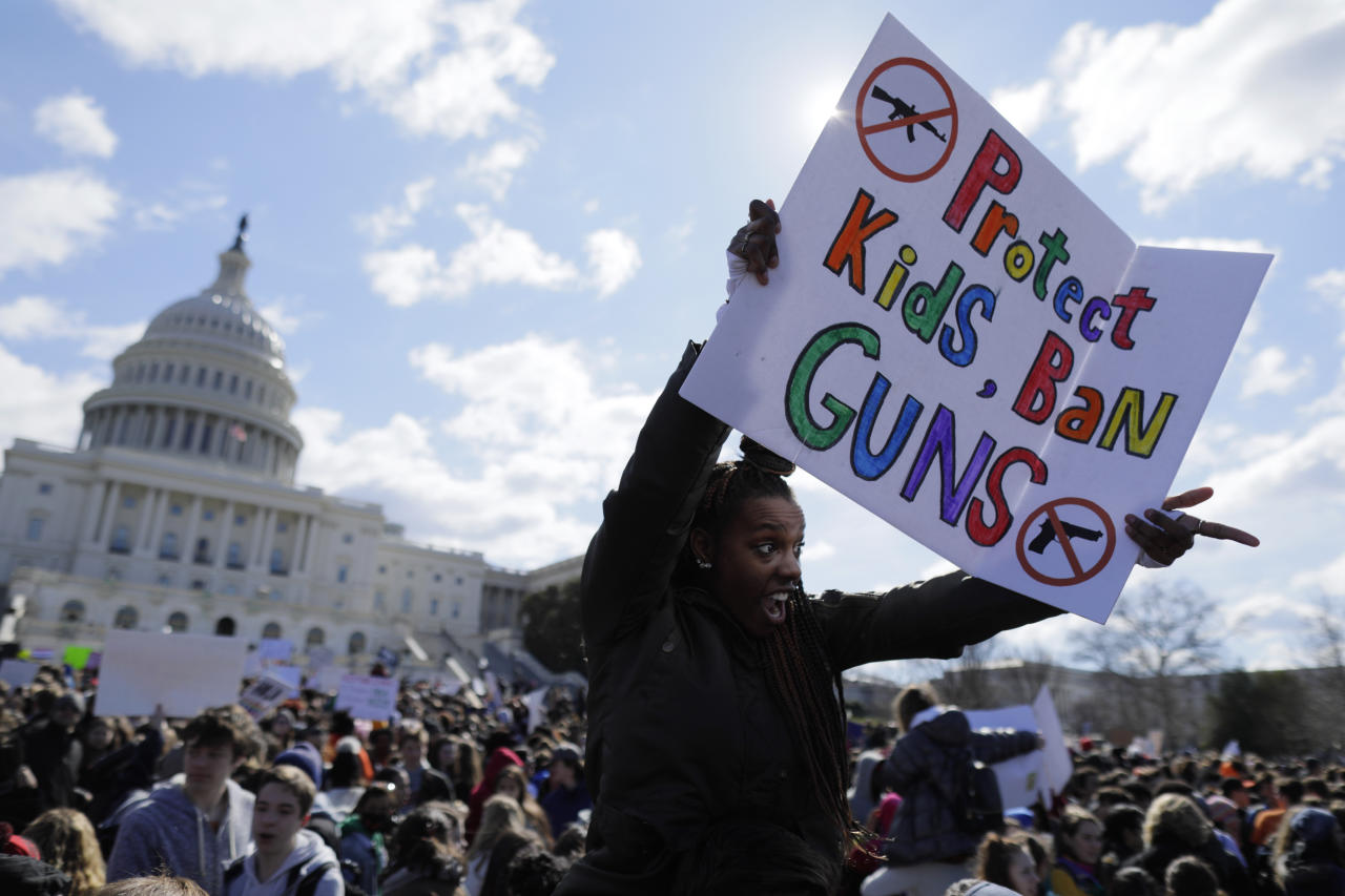 <p>Washington, DC High School student Sara Durbin joins with other students walking out of classes to demand stricter gun laws outside the U.S. Capitol in Washington, U.S., March 14, 2018. (Photo: Jim Bourg/Reuters) </p>