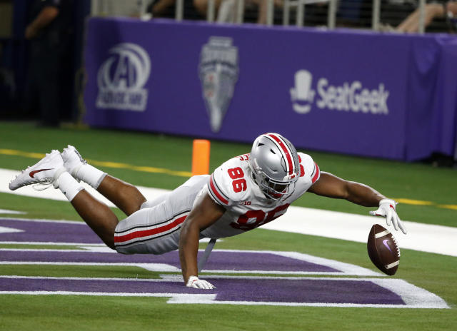 Ohio State defensive tackle Dre'Mont Jones (86) jumps on a TCU fumble that was recovered by Ohio State for a touchdown during the first half of an NCAA college football game in Arlington, Texas, Saturday, Sept. 15, 2018. (AP Photo/Michael Ainsworth)