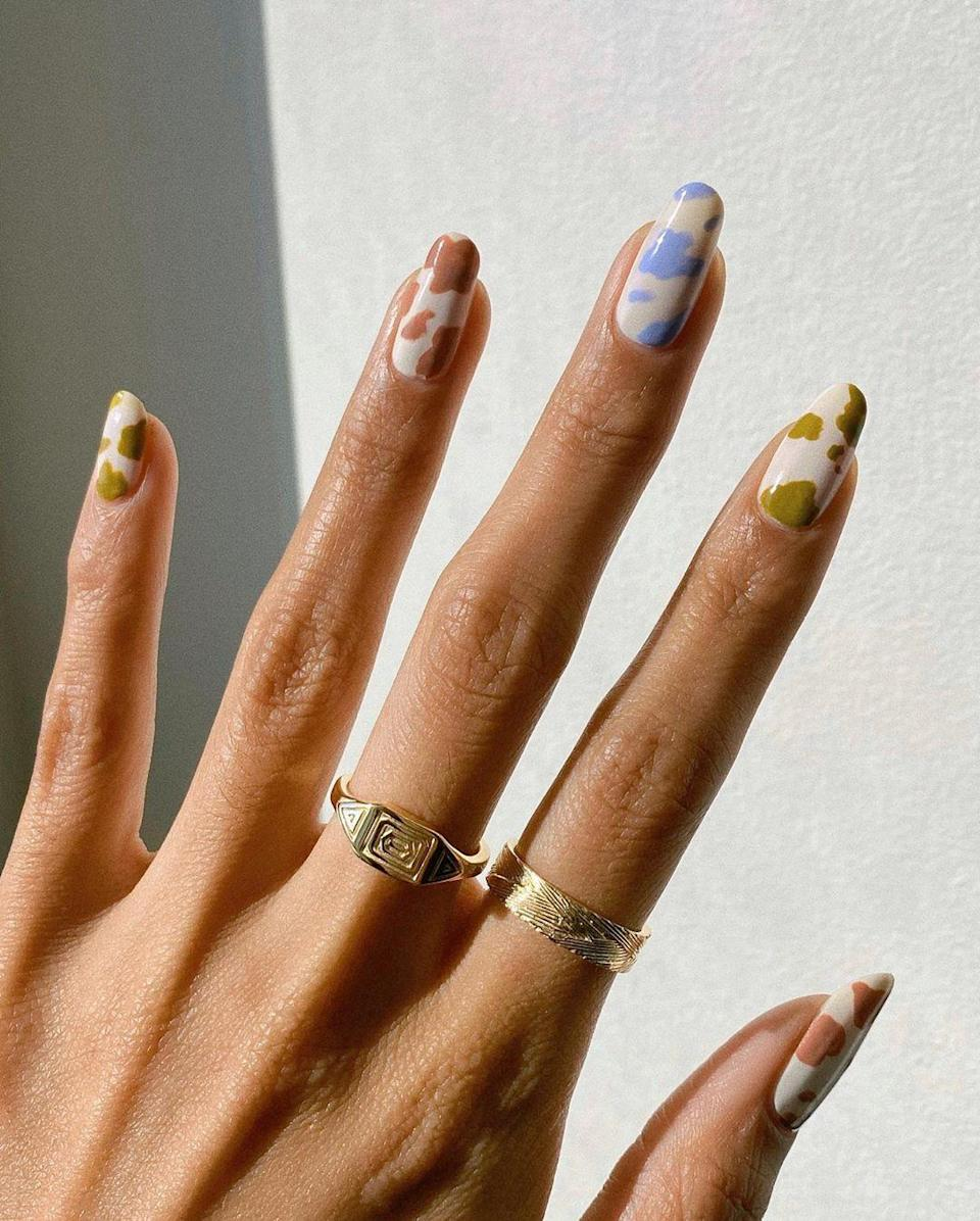 "<a href=""https://www.glamour.com/story/cow-print-nails?mbid=synd_yahoo_rss"" rel=""nofollow noopener"" target=""_blank"" data-ylk=""slk:Cow-print nails"" class=""link rapid-noclick-resp"">Cow-print nails</a> have become a staple thanks to Ariana Grande and Kendall Jenner. Switch it up and give it more of a fall feel with earthy tones like green, cream, and brown."