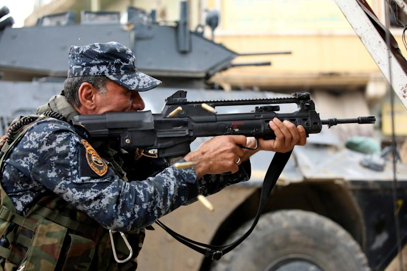 Iraq Mosul soldier police ISIS gun fight shooting