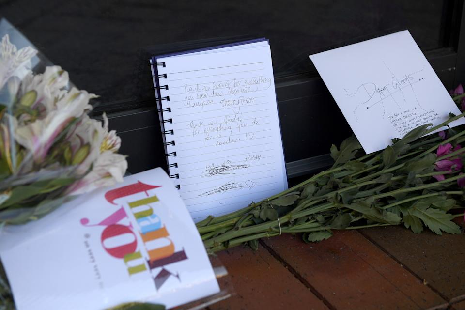 Handwritten messages and flowers are seen on the doorstep of Gladys Berejiklian's office.