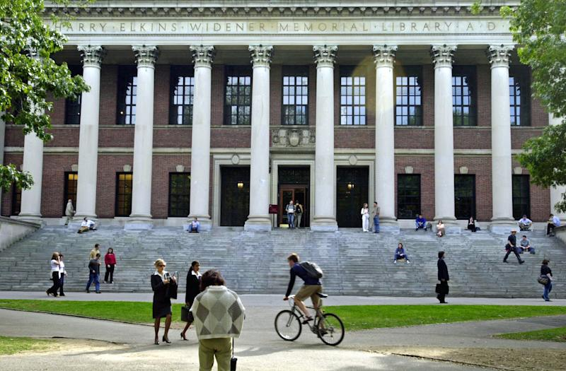 Students pass Harvard's Widener Library in a scene that already feels nostalgic. (William B. Plowman/Getty Images)