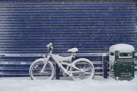 A bicycle is covered with snow near Grangemouth, Scotland, Britain, February 28, 2018. REUTERS/Russell Cheyne
