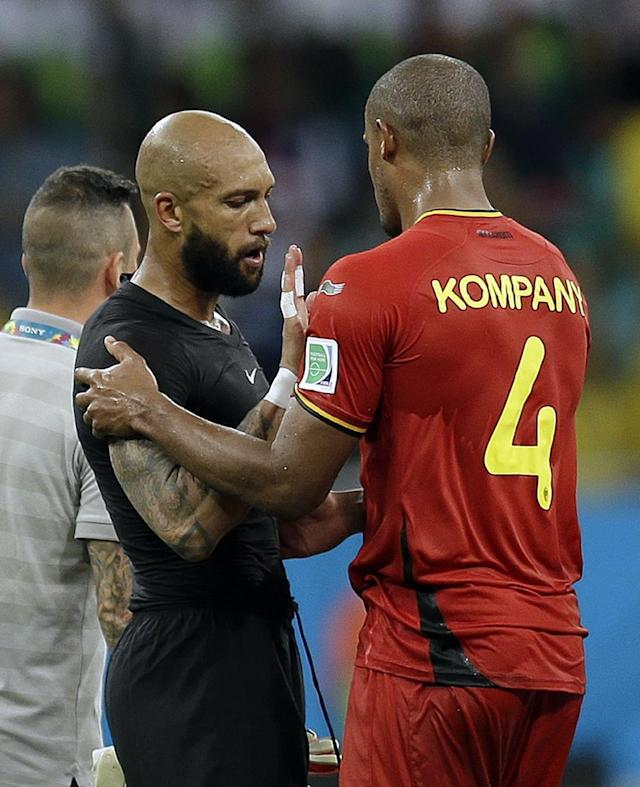 United States' goalkeeper Tim Howard talks to Belgium's Vincent Kompany after Belgium defeated the USA 2-1 in extra time to advance to the quarterfinals during the World Cup round of 16 soccer match between Belgium and the USA at the Arena Fonte Nova in Salvador, Brazil, Tuesday, July 1, 2014. (AP Photo/Natacha Pisarenko)