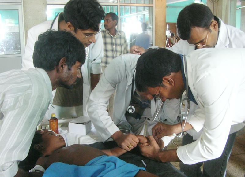 File photo shows medical staff treating a child suffering from Japanese encephalitis in Gorakhpur, some 300kms east of Lucknow, northern India on September 13, 2005