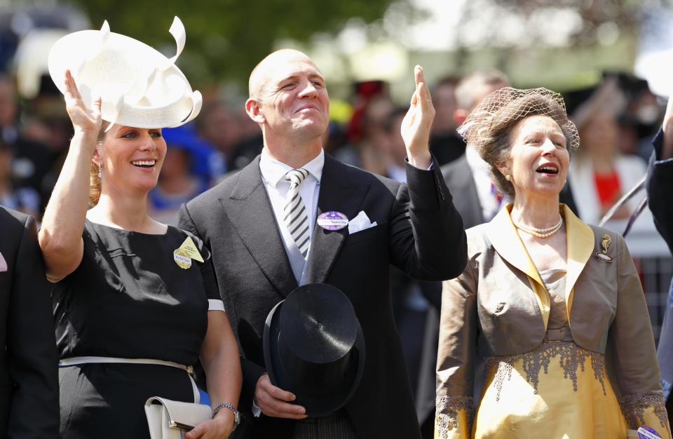 ASCOT, UNITED KINGDOM - JUNE 17: (EMBARGOED FOR PUBLICATION IN UK NEWSPAPERS UNTIL 48 HOURS AFTER CREATE DATE AND TIME) Zara Phillips, Mike Tindall and Princess Anne, The Princess Royal wave to Queen Elizabeth II and other members of The Royal Family in the carriage procession as they attend Day 1 of Royal Ascot at Ascot Racecourse on June 17, 2014 in Ascot, England. (Photo by Max Mumby/Indigo/Getty Images)