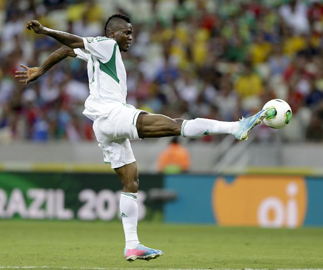 FILE - In this June 23, 2013, file photo, Nigeria's Brown Ideye kicks the ball during the soccer Confederations Cup group B match between Nigeria and Spain at the Castelao stadium in Fortaleza, Brazil. (AP Photo/Natacha Pisarenko,File)