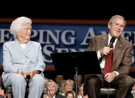 FILE PHOTO: U.S. President George W. Bush (R) jokes with his mother, Barbara Bush, while speaking about Medicare at the Boisfeuillet Jones Atlanta Civic Center in Atlanta, Georgia, July 22, 2005.  REUTERS/Larry Downing/File Photo