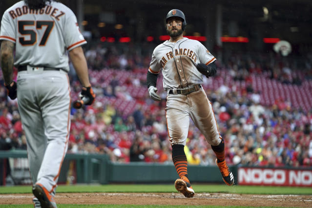 San Francisco Giants' Kevin Pillar scores a run on a single by Steven Duggar during the second inning of the team's baseball game against the Cincinnati Reds, Saturday, May 4, 2019, in Cincinnati. (AP Photo/Aaron Doster)