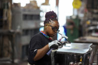 Sheet metal worker Carey Mercer assembles ductwork at Contractors Sheet Metal on Tuesday, Aug. 3, 2021, in New York. The construction industry is fighting to recruit more women into a sector that faces chronic labor shortages. Women make up only 4% of skilled construction laborers in the U.S. and often face discrimination on jobs sites. (AP Photo/Kevin Hagen)