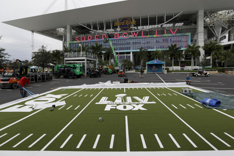 Rudy Morales works on the setup outside of the Hard Rock Stadium Monday, Jan. 27, 2020, in Miami Gardens, Fla., in preparation for the NFL Super Bowl 54 football game. (AP Photo/Chris Carlson)