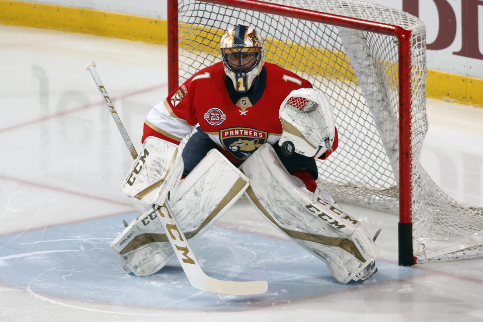 FILE - In this April 6, 2019, file photo, goaltender Roberto Luongo warms up prior to an NHL hockey game against the New Jersey Devils, in Sunrise, Fla. The Panthers are going to send Luongo's No. 1 jersey to the rafters and make him the first player in franchise history to receive that distinction during a ceremony before a game against Montreal, Luongo's hometown team, Saturday, March 7, 2020. (AP Photo/Joel Auerbach, File)