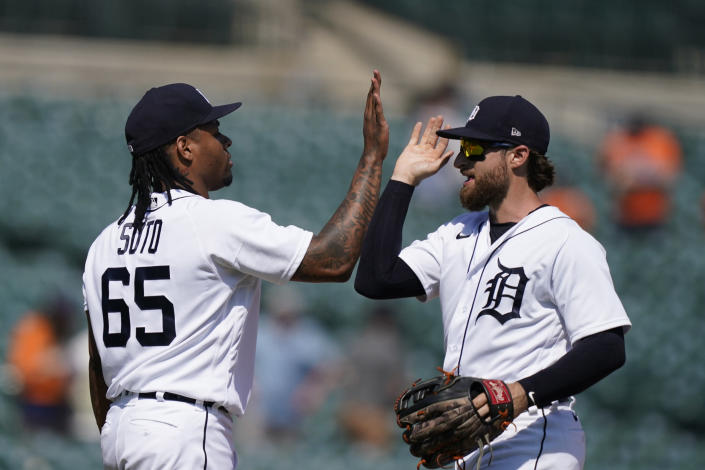 Detroit Tigers relief pitcher Gregory Soto (65) greets left fielder Eric Haase after the team's 8-3 win over the Seattle Mariners in a baseball game, Thursday, June 10, 2021, in Detroit. (AP Photo/Carlos Osorio)