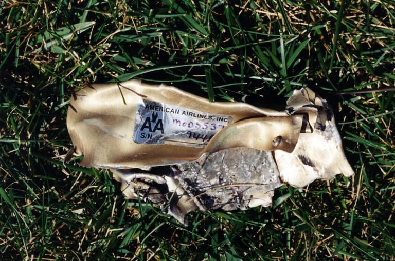 <p>A shard of the plane that hit the Pentagon lies on the ground (FBI) </p>