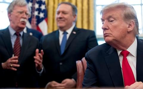 <span>John Bolton, Mike Pompeo and Donald Trump, left to right, in the White House</span> <span>Credit: AP Photo/Andrew Harnik </span>