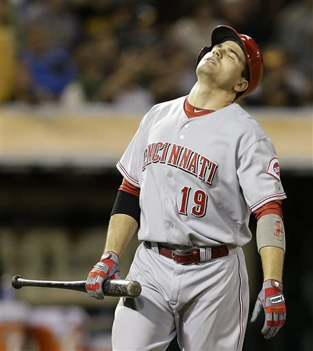 Cincinnati Reds' Joey Votto reacts after taking a strike from Oakland Athletics' Jerry Blevins in the sixth inning of a baseball game Tuesday, June 25, 2013, in Oakland, Calif. (AP Photo/Ben Margot)